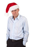 Bah Humbug Grumpy Man in Santa Hat Royalty Free Stock Image