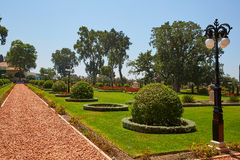 Bahai Gardens, a beautiful green lawn, wild grapes with flowerpots Stock Photo