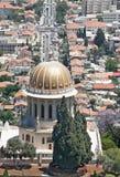 Bahai temple on background of Haifa stock images