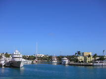 Bahamas. Landscape in the Bahamas, harbor and boats docked, blue water and sky royalty free stock images