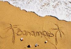 Bahamas beach sign. And waves stock image