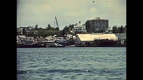 Bahamas coastline cruise. Waterfront cruise from Nassau to Paradise Beach through coastline and ports with fishing boats and hotels in 70`s with old buildings stock video