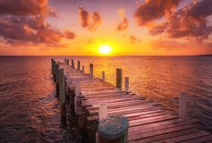 Bahamas dock sunset ocean royalty free stock photography