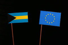 Bahamas flag with European Union EU flag isolated on black. Background Royalty Free Stock Photos