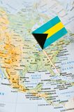 The Bahamas map and flag pin. Paper flag pin of the Bahamas on a map. It is an archipelagic state within the Lucayan Archipelago Royalty Free Stock Photo
