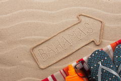 Bahamas pointer and beach accessories lying on the sand. As background stock photos
