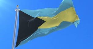 Bahamas señalan agitar por medio de una bandera en el viento en lento con el cielo azul, lazo