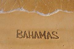 Bahamas word on sandy summer beach. Travel background stock images