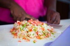 Bahamian conch salad. Close up of Bahamian woman making traditional conch salad Royalty Free Stock Photo