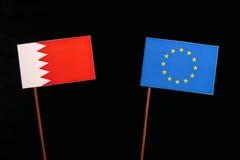 Bahrain flag with European Union EU flag isolated on black. Background Royalty Free Stock Images