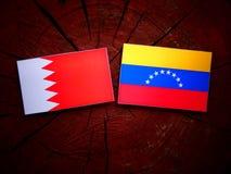 Bahrain. Flag with Venezuelan flag on a tree stump isolated Royalty Free Stock Image