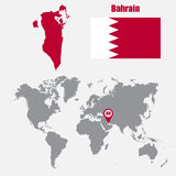 Bahrain map on a world map with flag and map pointer. Vector illustration Royalty Free Stock Photo