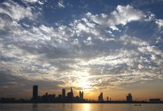 Bahrain skyline & beautiful cloud pattern observed during sunset stock photos