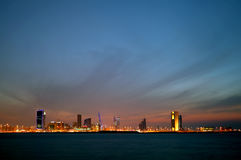 Bahrain skyline and the dark cloud during dusk Royalty Free Stock Image
