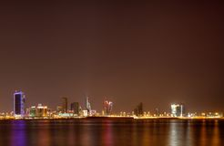 Bahrain skyline illuminated at night Royalty Free Stock Images