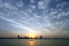 Bahrain Skyline and a speeding boat Royalty Free Stock Photography