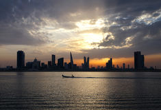 Bahrain skyline and speeding boat during sunset, HDR Stock Photos