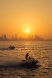 Bahrain Skyline at sunset with speed boats Stock Image