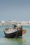 Bahraini old fishing boat. Old Bahraini fishing boat abandoned on the seaside Stock Image