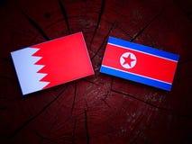 Bahrajn flaga z koreańczyk z korei północnej flaga na drzewnym fiszorku Zdjęcia Stock