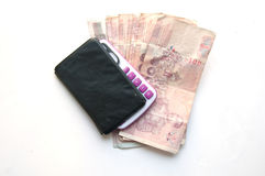 1000 baht banknotes and calculator. Close up of 1000 baht banknotes and calculator royalty free stock photos