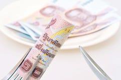 1000 baht bill on fork Stock Image