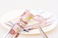 1000 baht bill on fork Stock Photography