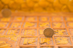 Baht coin on image of buddha& x27;s footprint. Stock Photography