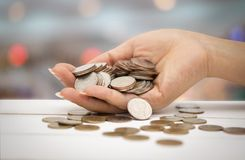The baht is in the hands on bokeh background stock photography