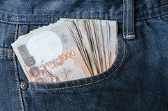 Baht money inside of jeans pocket thailand currency cash Royalty Free Stock Photo
