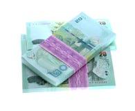 Baht thaïlandais de l'argent 20 d'isolement sur le fond blanc et thaïlandais de billet de banque Photos stock