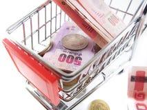 Baht thai money on shopping cart stock image