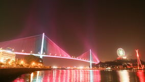 The Bai Chay Bridge in Ha Long, Vietnam lit up with colorful lighting at night stock video