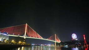 The Bai Chay Bridge in Ha Long, Vietnam lit up with colorful lighting at night. stock video footage
