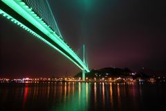 Bai chay bridge in halong bay Vietnam lit up with light green lighting Royalty Free Stock Image