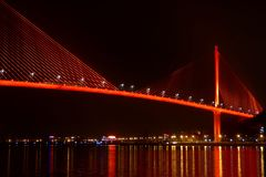 Bai chay bridge in halong bay Vietnam lit up with orange red lighting Royalty Free Stock Photos