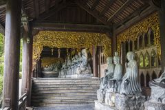 Bai Dinh Buddhist Temple,  Vietnam. Bai Dinh Buddhist Temple, Row of sculptures in the cloister, Ninh Bình Province, Vietnam royalty free stock photos