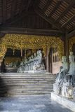 Bai Dinh Buddhist Temple,  Vietnam. Bai Dinh Buddhist Temple, Row of sculptures in the cloister, Ninh Bình Province, Vietnam stock photo