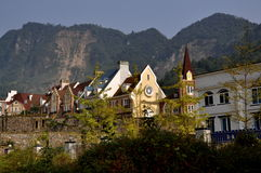 Bai Lu, China: View of French-inspired Village. View of the romantic French-inspired village of Bai Lu China with its steeply gabled roofs and chimneys nestled Royalty Free Stock Photos