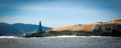 Baia de Guanabara. Lighthouse on coastline of Baia de Guanabara, Rio de Janeiro, Brazil royalty free stock images
