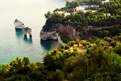 Baia delle Zagare, shore and sea stacks. Vieste, Gargano, Apulia, Italy. For travel and vacation concept Stock Images
