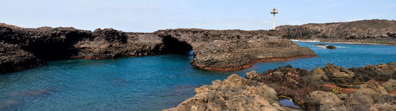 Baia and it's Natural Arch. Baia - A natural bay formed by volcanic lava from past eruptions with natural arch surrounded by the blue waters of the Atlantic Stock Images