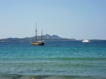 Baia Sardinia - Sailing boat Royalty Free Stock Photo