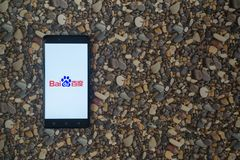Baidu logo on smartphone on background of small stones. Los Angeles, USA, october 18, 2017: Baidu logo on smartphone on background of small stones stock image