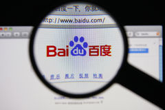 Baidu. Photo of Baidu homepage on a monitor screen through a magnifying glass stock photos