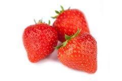 Baie de fraises sur le fond blanc Photographie stock