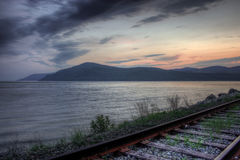 Baie saint-paul with railroads. On the side of the water Royalty Free Stock Image