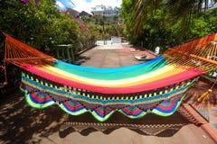 Baie San Juan Del Sur Nicaragua de l'eau de plage de RelaxOcean d'hamac d'arc-en-ciel photographie stock