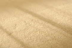 Baige carpet. Braight baige carpet close up with window shadow royalty free stock photos