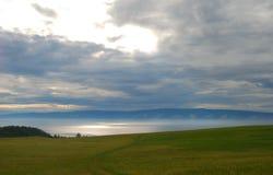 Baikal lake. Side of the Baikal lake, evening, getting rainy Royalty Free Stock Image